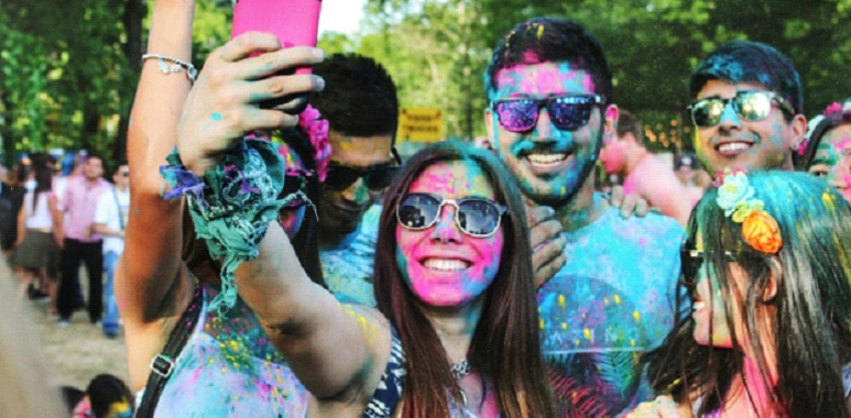Couple people with paint taking a selfie