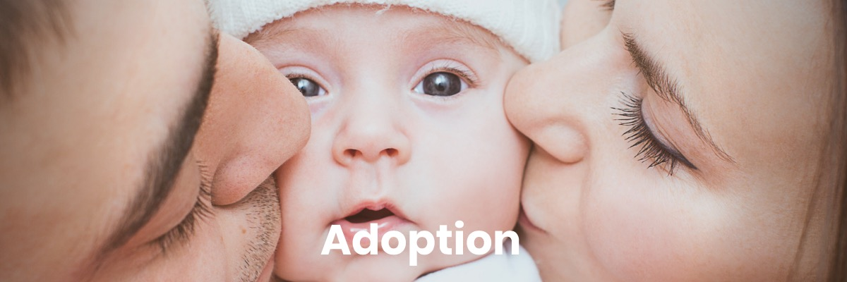 Couple kissing baby with the caption Adoption